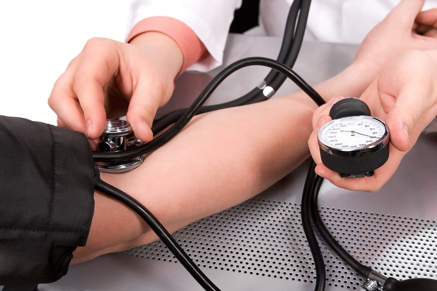 bigstock-doctor-checking-blood-pressure-17566802-min