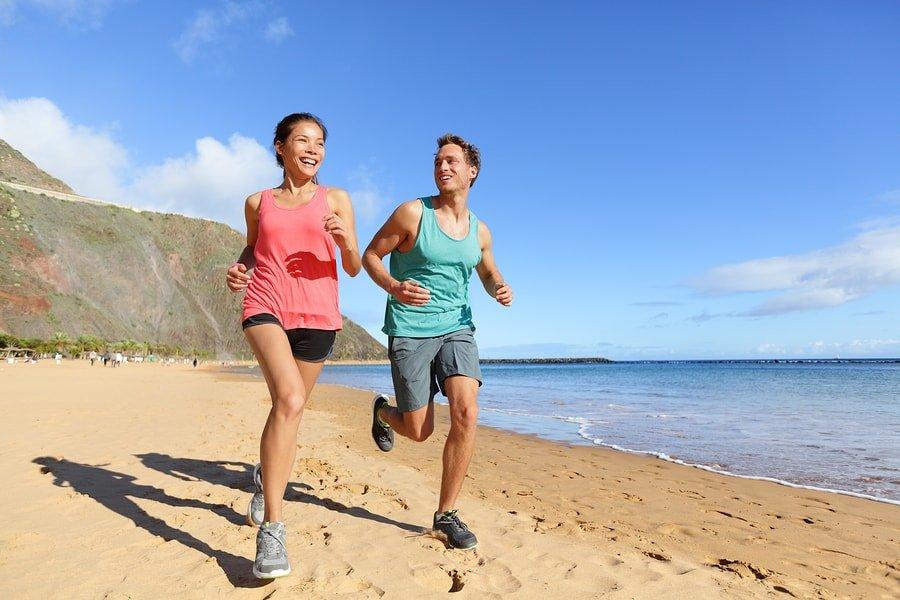 bigstock-runners-running-on-beach-jogg-90536186-min
