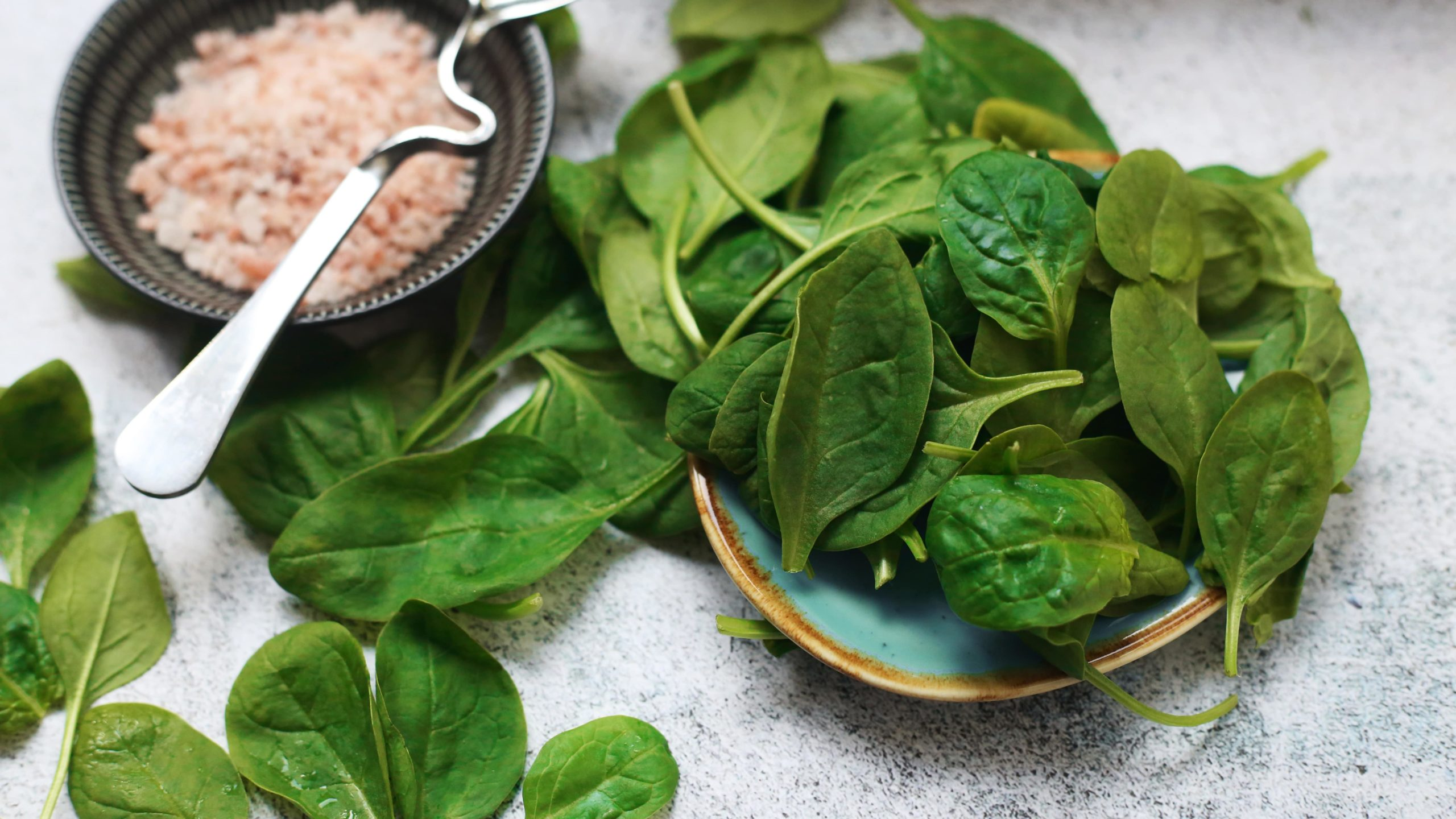 Spinach is a source of vitamin K. Increasing intake and supplements are usually safe, but side effects are possible